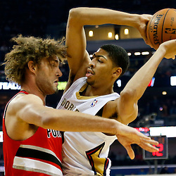 Dec 30, 2013; New Orleans, LA, USA; New Orleans Pelicans power forward Anthony Davis (23) works against Portland Trail Blazers center Robin Lopez (42) during the first quarter of a game at the New Orleans Arena. Mandatory Credit: Derick E. Hingle-USA TODAY Sports