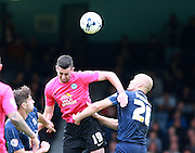 Southend player Adam Barrett and Peterborough United player Joe Gormley compete for a high ball during the Sky Bet League 1 match between Southend United and Peterborough United at Roots Hall, Southend, England on 5 September 2015. Photo by Bennett Dean.