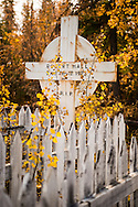 Mayo, Yukon Territory, Canada, September 2014. A historical cemetery in Mayo, with graves dating back to the Gold rush and silver era. With scenic drives in abundance, the Yukon Territory is a driver's dream. The territory boasts a network of well-maintained highways leading through an exhilarating combination of postcard scenery, historic communities, cultural attractions and adventure outings.The Yukon Territory received world fame during the Klondike Gold Rush in 1898.  Photo by Frits Meyst / MeystPhoto.com