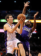 Dec. 17, 2012; Phoenix, AZ, USA; Phoenix Suns guard Goran Dragic (1) lays up the ball during the game against the Sacramento Kings guard Aaron Brooks (3) in the second half at US Airways Center. The Suns defeated the Kings 101-90.  Mandatory Credit: Jennifer Stewart-USA TODAY Sports