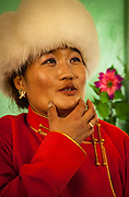 Woman at party, festival of one thousand camels, Bulgan, Gobi desert in winter, Mongolia