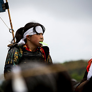 "MINAMISOMA, JAPAN - JULY 24 :  A young samurai horsewoman is seen after completing the race in the Kacchu-keiba (armed horse race) during the Soma Nomaoi festival at Hibarigahara field on Sunday, July 24, 2016 in Minamisoma, Japan. ""Soma-Nomaoi"" is a traditional festival that recreates a samurai battle scene from more than 1,000 years ago. (Photo: Richard Atrero de Guzman/NURPhoto)"