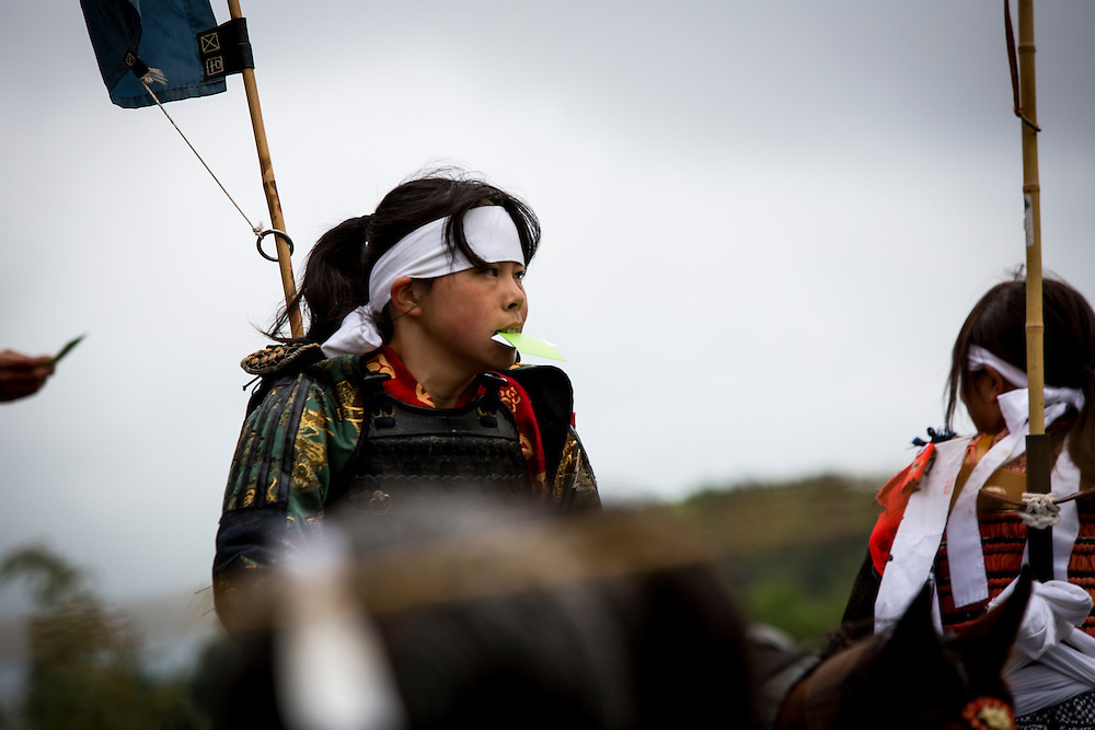 """MINAMISOMA, JAPAN - JULY 24 :  A young samurai horsewoman is seen after completing the race in the Kacchu-keiba (armed horse race) during the Soma Nomaoi festival at Hibarigahara field on Sunday, July 24, 2016 in Minamisoma, Japan. """"Soma-Nomaoi"""" is a traditional festival that recreates a samurai battle scene from more than 1,000 years ago. (Photo: Richard Atrero de Guzman/NURPhoto)"""