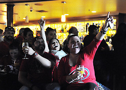 From right, Crystal Castillo, Julie Juarez and Octavio Mendez celebrate Sunday's San Francisco 49ers victory over the Carolina Panthers. Bars such as Lallapalooza in south Salinas were full of football fans for the occasion.