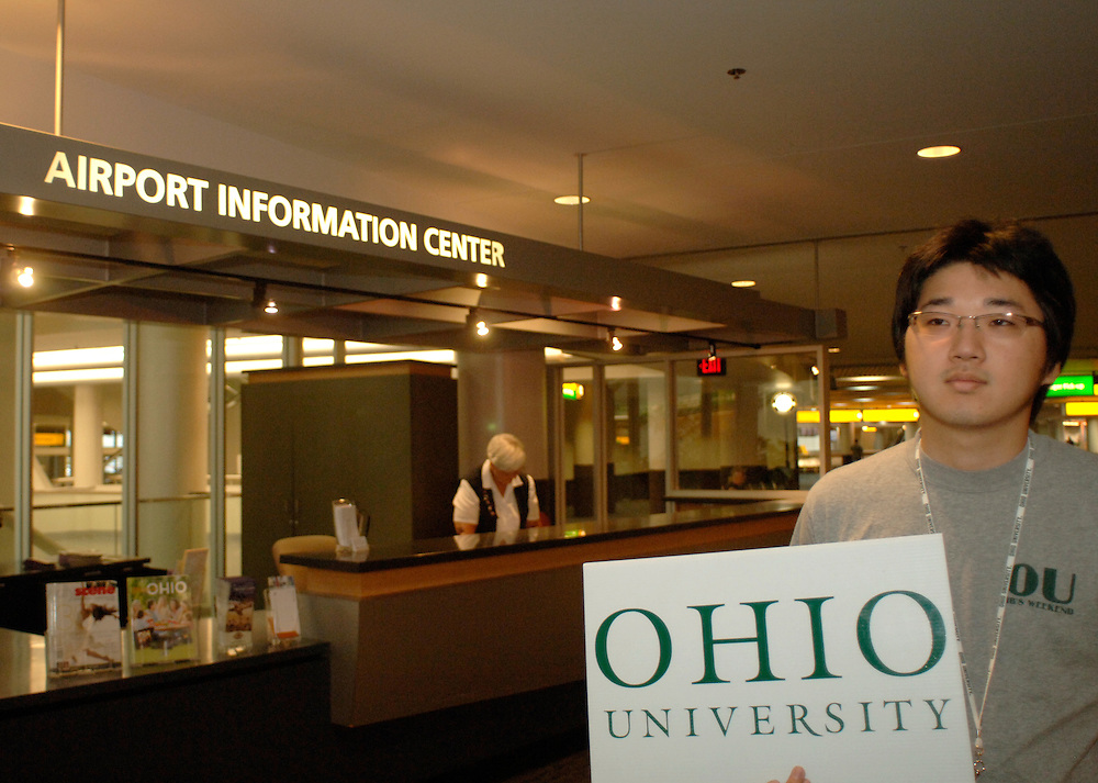 International students at Airpot Photos by Megan Nadolski..Ohio University peer advisor Simon Byung Ho Lee waits for new Ohio University international students to arrive at the airport in Columbus, OH.