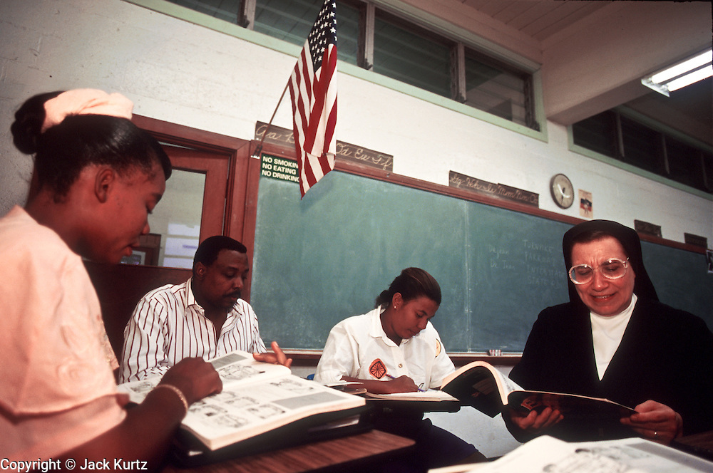 18 SEPTEMBER 1994 - MIAMI, FLORIDA, USA: Sister Yamile Saleh teaches English to Haitian immigrants at the Notre Dame D'Haiti Catholic Church, a church and community center serving the Haitian emigre community in Miami, FL. Services at the church are conducted in Creole.  PHOTO © JACK KURTZ   REFUGEES  WOMEN  RELIGION   CULTURE