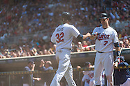 Aaron Hicks #32 of the Minnesota Twins is congratulated by Joe Mauer #7 after scoring against the Seattle Mariners on June 2, 2013 at Target Field in Minneapolis, Minnesota.  The Twins defeated the Mariners 10 to 0.  Photo: Ben Krause