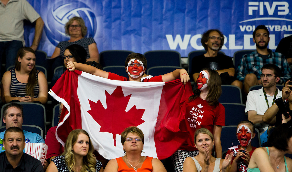 Fans cheer as Canada enters the court to play Korea at a World League Volleyball match at the Sasktel Centre in Saskatoon, Saskatchewan Canada on June 24, 2016.