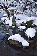 "Kotoji-toro, a stone lantern with two legs, said to resemble the bridge on a koto. This lantern is the symbol of Kenrokuen and Kanazawa.  Kenroku-en or the ""Six Attributes Garden"" (spaciousness, seclusion, artifice, antiquity, watercourses and panoramas)  along with Kairakuen and Korakuen, is one of the Three Great Gardens of Japan."