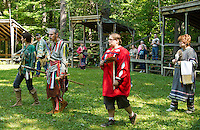 "Karey Caldwell ""Sparrow"" and James Clemens ""Wolf Spirit"" lead clockwise around the circle during the Veteran's dance at the Laconia Indian Historical Association's Pow Wow on Sunday afternoon in Sanbornton.  (Karen Bobotas/for the Laconia Daily Sun)"