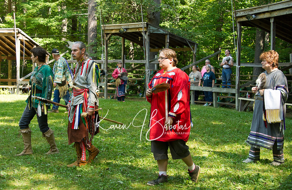 """Karey Caldwell """"Sparrow"""" and James Clemens """"Wolf Spirit"""" lead clockwise around the circle during the Veteran's dance at the Laconia Indian Historical Association's Pow Wow on Sunday afternoon in Sanbornton.  (Karen Bobotas/for the Laconia Daily Sun)"""
