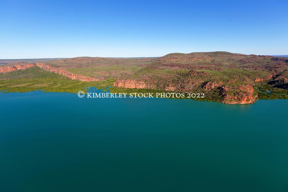 Mangroves meet sandstone cliffs on the Kimberley coast near the Hunter River.