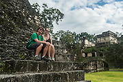 The ruins of the ancient Mayan city Tikal lie in present day Guatamala, near the border of Belize.