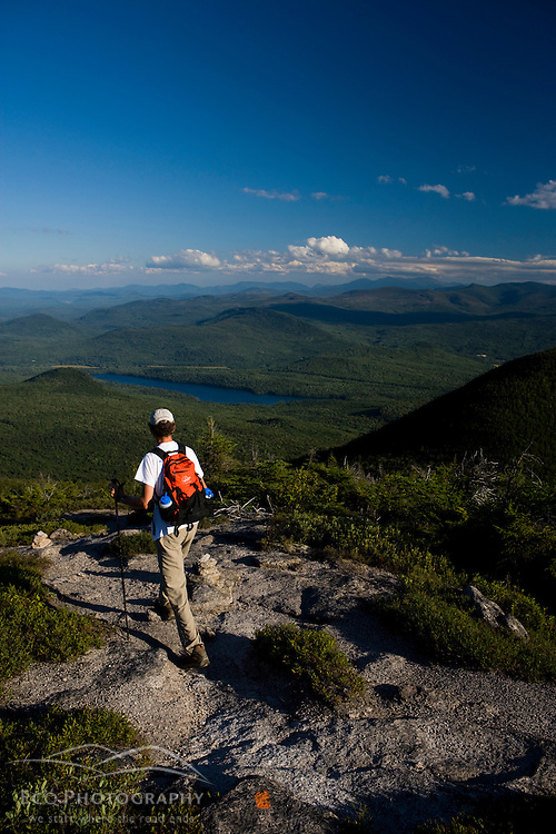 A hiker on the Cohos Trail near the summit of North Percy Peak.  Nash Stream State Forest, Stratford, New Hampshire.