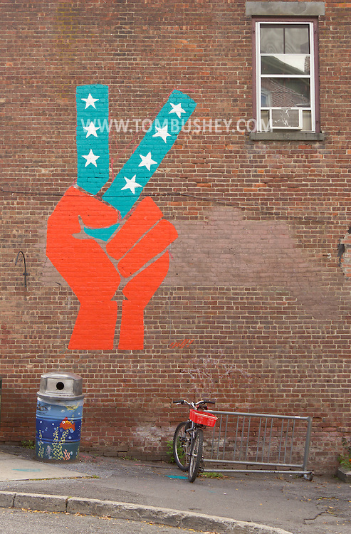 New Paltz, New York - A large peace sign painting on a brick wall in Village of New Paltz on Oct. 1, 2012.