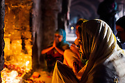 "19th March 2015, New Delhi, India. A woman prays to Djinns in the hopes of getting her wishes granted in the ruins of Feroz Shah Kotla in New Delhi, India on the 19th March 2015<br /> <br /> PHOTOGRAPH BY AND COPYRIGHT OF SIMON DE TREY-WHITE a photographer in delhi<br /> + 91 98103 99809. Email: simon@simondetreywhite.com<br /> <br /> People have been coming to Firoz Shah Kotla to leave written notes and offerings for Djinns in the hopes of getting wishes granted since the late 1970's. Jinn, jann or djinn are supernatural creatures in Islamic mythology as well as pre-Islamic Arabian mythology. They are mentioned frequently in the Quran  and other Islamic texts and inhabit an unseen world called Djinnestan. In Islamic theology jinn are said to be creatures with free will, made from smokeless fire by Allah as humans were made of clay, among other things. According to the Quran, jinn have free will, and Iblīs abused this freedom in front of Allah by refusing to bow to Adam when Allah ordered angels and jinn to do so. For disobeying Allah, Iblīs was expelled from Paradise and called ""Shayṭān"" (Satan).They are usually invisible to humans, but humans do appear clearly to jinn, as they can possess them. Like humans, jinn will also be judged on the Day of Judgment and will be sent to Paradise or Hell according to their deeds. Feroz Shah Tughlaq (r. 1351–88), the Sultan of Delhi, established the fortified city of Ferozabad in 1354, as the new capital of the Delhi Sultanate, and included in it the site of the present Feroz Shah Kotla. Kotla literally means fortress or citadel."