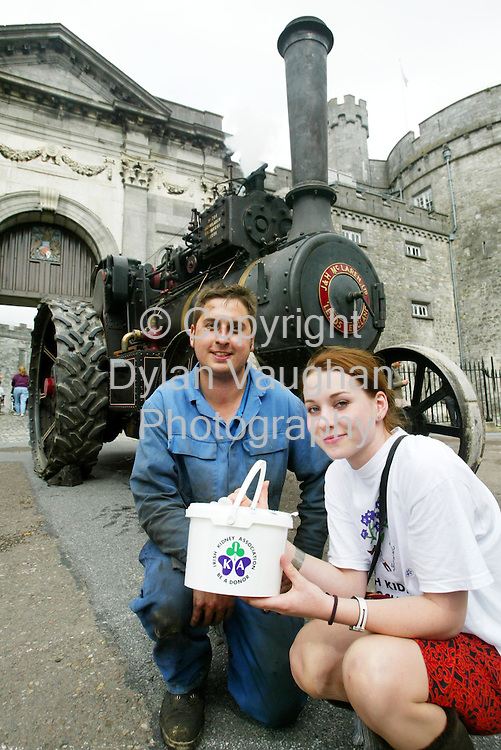 29/7/2004.Wesley Glynn from Carlow and Rebecca Leech from Wexford pictured in Kilkenny with one of the many Steam Engines taking part in the Irish Kidney Association in Association with Celtic Steamers, Steam Engine Road Run 2004 which will travel from Kilkenny to Stradbally County Laois from the 29th of July-31 of July..Picture Dylan Vaughan