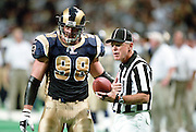 Defensive end Grant Wistrom (98) of the St. Louis Rams has a discussion with the Referee during a 48 to 14 win over the Carolina Panthers on 11/11/2001..©Wesley Hitt/NFL Photos