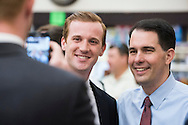 Republican presidential candidate Wisconsin Gov. Scott Walker takes a photo with a supporter at the Highland Park Soda Fountain in Dallas, Texas on September 2, 2015. (Cooper Neill for the Texas Tribune)