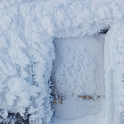 Rime ice coats a door way on a building on the summit of New Hampshire's Mount Washington in winter.