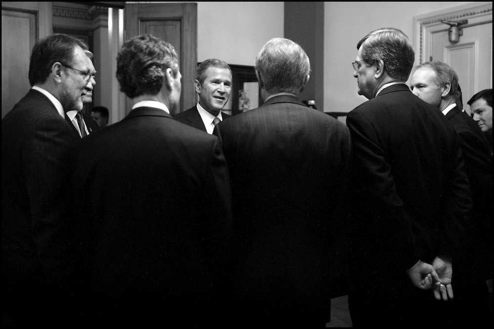 President Bush speaks with the Congressional Escort Committee who will take him to the House Chamber for his speech to a joint session of Congress. 9/20/01..©PF BENTLEY/PFPIX.com