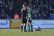 Scunthorpe United  Tom Hopper (14)  is given a yellow card by Referee Darren Handley during the EFL Sky Bet League 1 match between Bristol Rovers and Scunthorpe United at the Memorial Stadium, Bristol, England on 24 February 2018. Picture by Gary Learmonth.