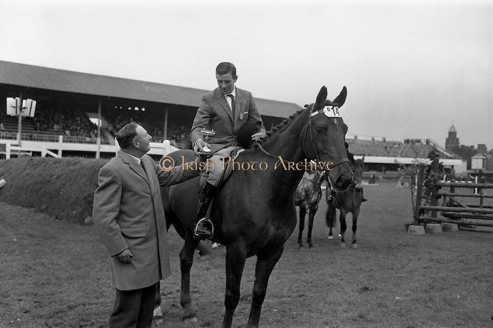 08/05/1964<br /> 05/08/1964<br /> 08 May 1964<br /> R.D.S. Spring Show Ballsbridge Dublin, Championship Showjumping. Mr. H. Barrington-Jellett (left), President of the R.D.S. presenting the Schwepps Cup to Mr. Seamus Hayes on &quot;Goodbye&quot;, winner of Championship Competition &quot;O&quot; at the Dublin Spring Show. &quot;Goodbye&quot; was owned by Mr. Joseph J. McGrath.