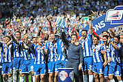 Wigan lift the League 1 trophy after during the Sky Bet League 1 match between Wigan Athletic and Barnsley at the DW Stadium, Wigan, England on 8 May 2016. Photo by John Marfleet.