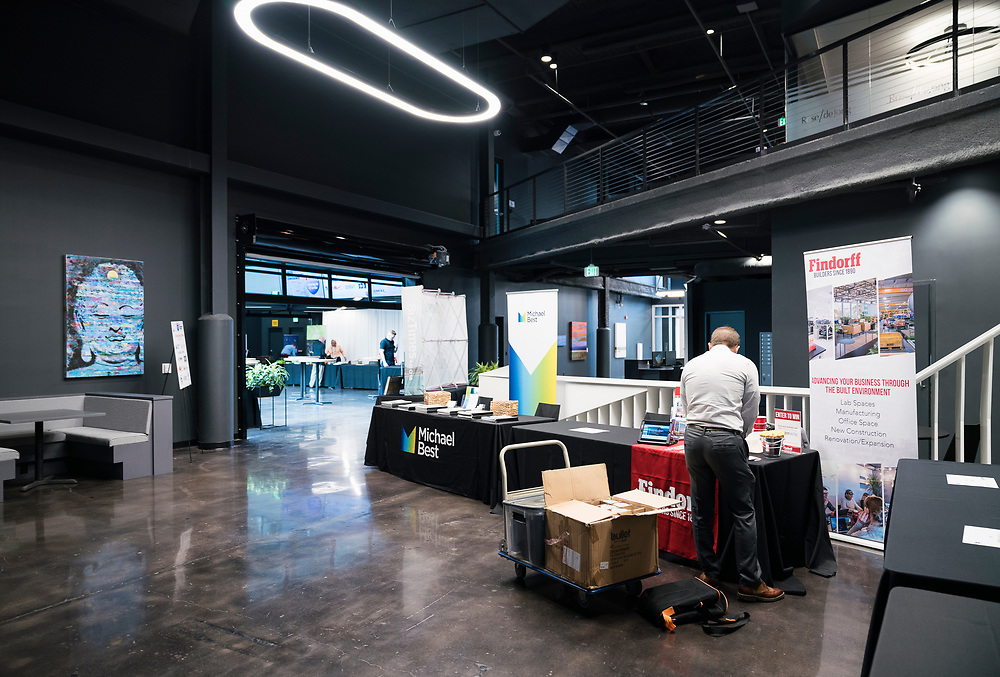 Sponsors set up their booths before the Wisconsin Entrepreneurship Conference at Venue 42 in Milwaukee, Wisconsin, Tuesday, June 4, 2019.
