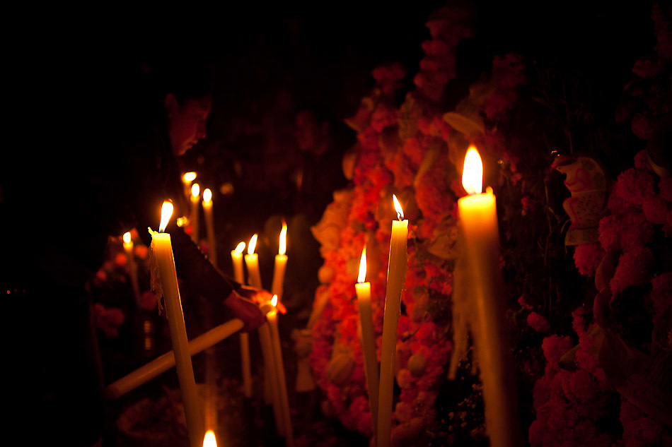 "In the state of Michoacán, Mexico, Purepecha indigenous communities await the return of the deceased on Janitzio Island in Lake Patzcuaro on ""Noche de Muertos"" (Day of the Dead), a ritual expressions with profound significance. Cempasuchil Flowers (Marigold Flowers), candles, fruit bread and incense are used as offerings in this cheerful and solemn occasion. ..©Benjamin B Morris"