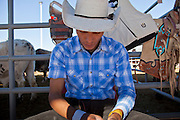 26 NOVEMBER 2011 - CHANDLER, AZ:   A barebronc rider, tapes up his before competing at the Grand Canyon Pro Rodeo Association (GCPRA) Finals at Rawhide Western Town in west Chandler, AZ, about 20 miles from Phoenix Saturday. The GCPRA Finals is the last rodeo of the GCPRA season. The GCPRA is a professional rodeo association based in Arizona.    PHOTO BY JACK KURTZ