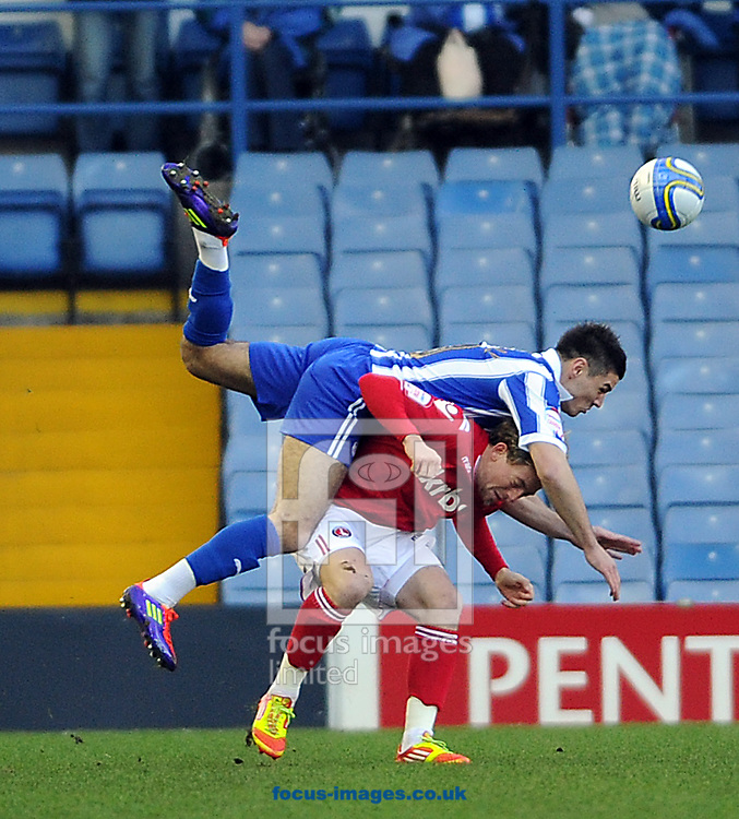 Picture by Graham Crowther/Focus Images Ltd. 07763140036.14/01/12.Ben Marshall of Sheffield Wednesday climbs on Danny Green  of Charlton during the Npower League 1 game at Hillsborough stadium, Sheffield.
