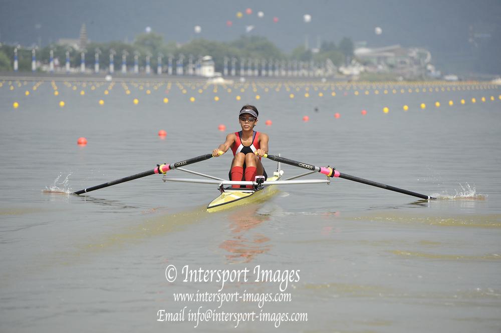 Chungju, South Korea.    SIN LW1X Aisyah SAIYIDAH. ) moves away from the start, Semi final A/B.  2013 Rowing Championships, Tangeum Lake, International Regatta Course.  Sunday  25/08/2013 [Mandatory Credit. Peter Spurrier/Intersport Images]