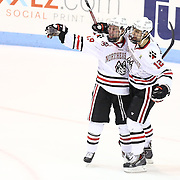 Zach Aston-Reese #12 of the Northeastern Huskies and Mike Szmatula #19 of the Northeastern Huskies celebrate a goal during the game at Matthews Arena on February 22, 2014 in Boston, Massachusetts. (Photo by Elan Kawesch)