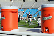 CHARLOTTE, NC - NOVEMBER 7:  Jason Kyle #56 of the Carolina Panthers walks toward the Gatorade coolers on the sidelines against the Oakland Raiders at Bank of America Stadium on November 7, 2004 in Charlotte, North Carolina. The Raiders defeated the Panthers 27-24. ©Paul Anthony Spinelli  *** Local Caption *** Jason Kyle