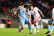 Milton Keynes Dons midfielder (on loan from Middlesbrough) Marcus Tavernier(17) shoots under pressure from Coventry City defender Chris Stokes (3) during the The FA Cup 4th round match between Milton Keynes Dons and Coventry City at stadium:mk, Milton Keynes, England on 27 January 2018. Photo by Dennis Goodwin.