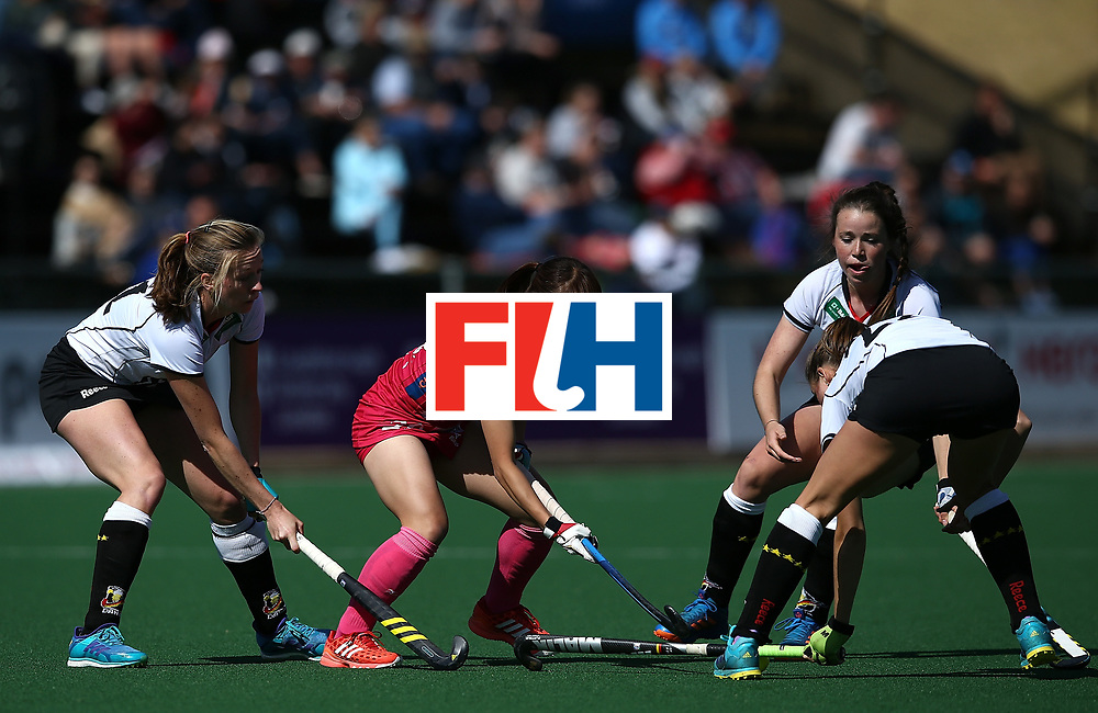 JOHANNESBURG, SOUTH AFRICA - JULY 16:  Minami Shimizu of Japan is blocked by Franziska Hauke, Cecile Pieper and Charlotte Stapenhorst of Germany during day 5 of the FIH Hockey World League Women's Semi Finals Pool A match between Japan and Germany at Wits University on July 16, 2017 in Johannesburg, South Africa.  (Photo by Jan Kruger/Getty Images for FIH)