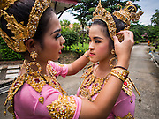 31 AUGUST 2014 - SARIKA, NAKHON NAYOK, THAILAND: Thai dancers get ready to perform during the Ganesh Festival at Shri Utthayan Ganesha Temple in Sarika, Nakhon Nayok. Ganesh Chaturthi, also known as Vinayaka Chaturthi, is a Hindu festival dedicated to Lord Ganesh. It is a 10-day festival marking the birthday of Ganesh, who is widely worshiped for his auspicious beginnings. Ganesh is the patron of arts and sciences, the deity of intellect and wisdom -- identified by his elephant head. The holiday is celebrated for 10 days, in 2014, most Hindu temples will submerge their Ganesh shrines and deities on September 7. Wat Utthaya Ganesh in Nakhon Nayok province, is a Buddhist temple that venerates Ganesh, who is popular with Thai Buddhists. The temple draws both Buddhists and Hindus and celebrates the Ganesh holiday a week ahead of most other places.    PHOTO BY JACK KURTZ