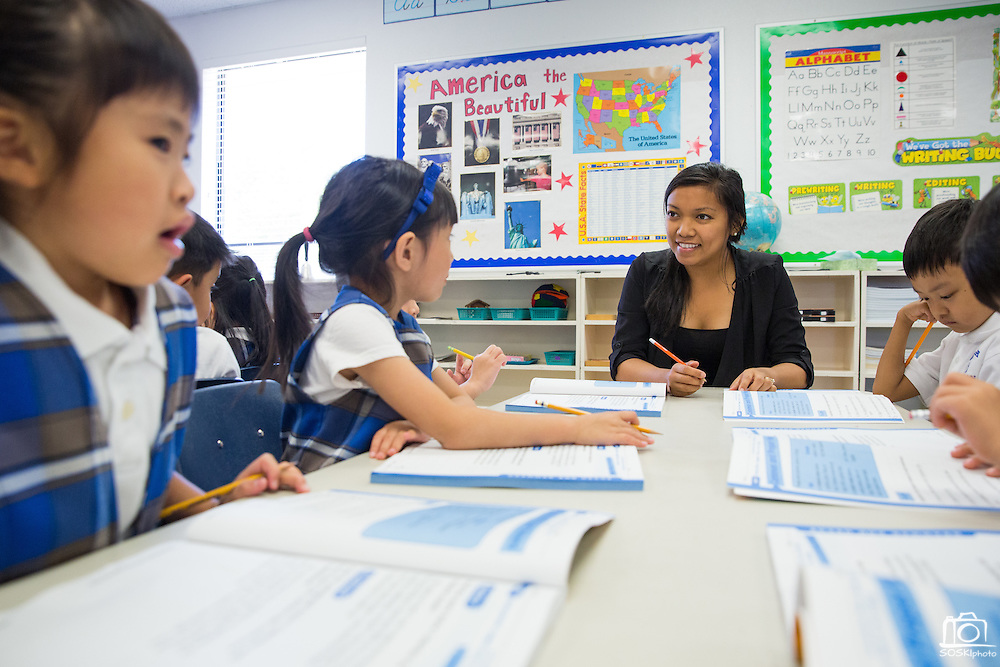 Students perform activities in groups and individually at Monarch Christian Academy in Milpitas, California, on September 12, 2014. (Stan Olszewski/SOSKIphoto)