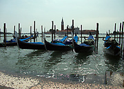 Gondolas moored at St Mark's square, Venice, Italy.