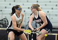Central Bucks West's Jacq Fitzgerald #39 makes a shot as Central Bucks East's Julia Adams #24 defends in the first half at War Memorial Field Friday April 10, 2015 in Doylestown, Pennsylvania.  (Photo by William Thomas Cain/Cain Images)