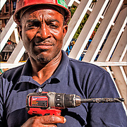 Cliff Freser African American Ironworker Local 580 onsite at the AIDS Memorial posing holding drill.