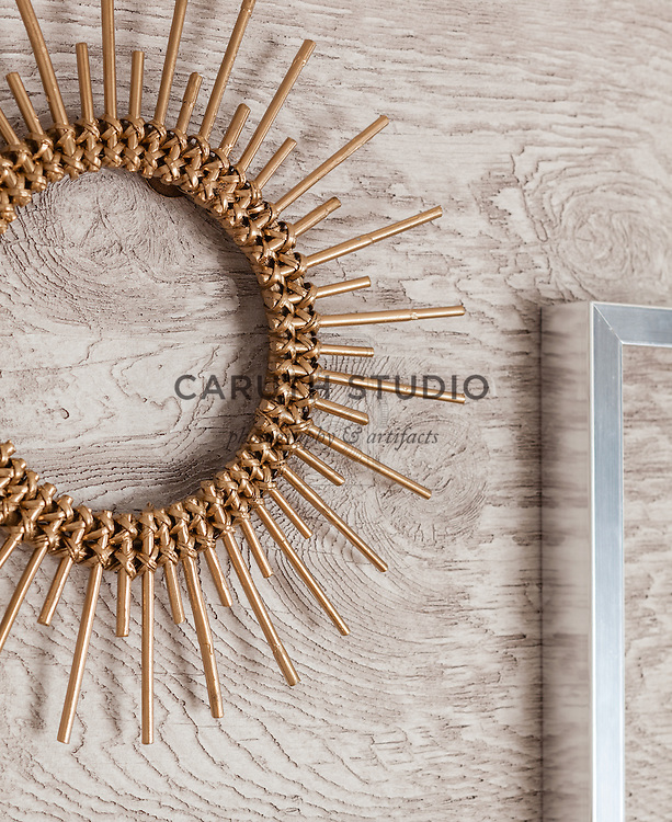 One Dresser Three Ways: Detail of metallic frames on textured wood wallpaper
