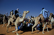 Touaregs riding their camels during the camel festival, Ghat, Libya