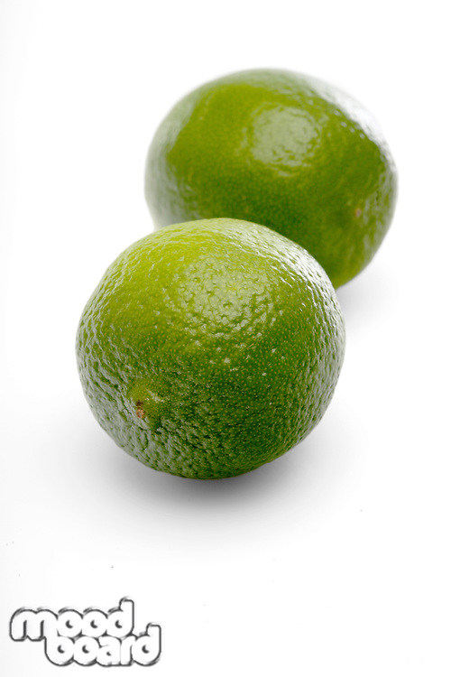 Limes on white background - close-up