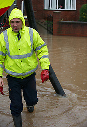 © Licensed to London News Pictures. 26/11/2012..Carlin How, England..A huge part of the main road through Carlin How in East Cleveland was flooded following another night of heavy rain that caused disruption in parts of East Cleveland and North Yorkshire. A local firm was brought in to try and clear away some of the water from the road...Photo credit : Ian Forsyth/LNP