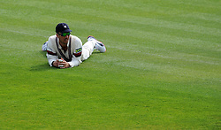 Dejection for Somerset's Tom Cooper. - Photo mandatory by-line: Harry Trump/JMP - Mobile: 07966 386802 - 13/04/15 - SPORT - CRICKET - LVCC County Championship - Day 2 - Somerset v Durham - The County Ground, Taunton, England.