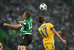 October 31, 2017 - Lisbon, Portugal - Sporting's defender Stefan Ristovsk from Macedonia (L) heads the ball with Juventus' Croatian forward Mario Mandzukic during the UEFA Champions League football match Sporting CP vs Juventus at the Alvalade stadium in Lisbon, Portugal on October 31, 2017. (Credit Image: © Pedro Fiuza/NurPhoto via ZUMA Press)