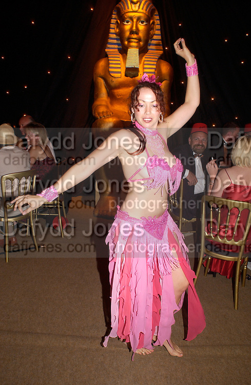 Belly dancer, Revival party 2003, Goodwood racetrack. 6 September 2003.© Copyright Photograph by Dafydd Jones 66 Stockwell Park Rd. London SW9 0DA Tel 020 7733 0108 www.dafjones.com