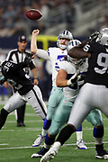 Dallas Cowboys quarterback Cooper Rush (7) has the ball knocked out of his hand for a pick six interception return for a touchdown by the Oakland Raiders in the third quarter during the 2017 NFL week 3 preseason football game against the Oakland Raiders, Saturday, Aug. 26, 2017 in Arlington, Tex. The Cowboys won the game 24-20. (©Paul Anthony Spinelli)